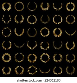 Set of gold award laurel wreaths and branches on dark background, vector illustration.