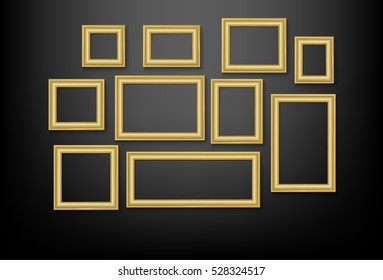 set of gold picture frame on black wall
