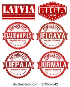 Set of grunge rubber stamps with names of Latvia cities, vector illustration
