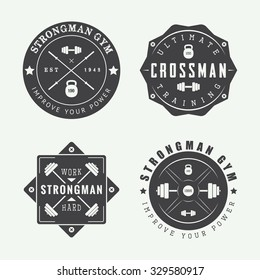 Set of gym logos, labels and slogans in vintage style. Vector illustration