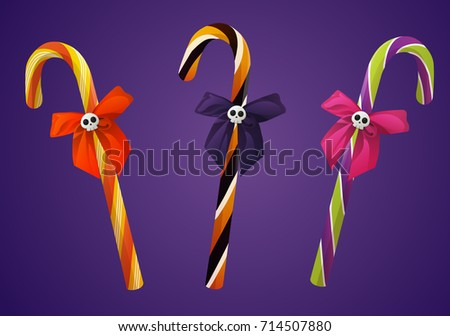 set of halloween candy canes with skull and bow