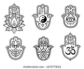 "Set of Hamsa hand drawn symbol, lotus flower, Yin-Yang and OM sigils. Decorative pattern in oriental style for interior decoration and henna drawings. The ancient sign of ""Hand of Fatima""."