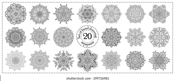 Set of hand drawing zentangle elements. Black and white. Flower mandala. Vector illustration. The best for your design, textiles, posters, tattoos, corporate identity