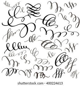 Set of hand drawn calligraphic swirls.