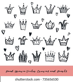 Set of hand drawn doodle crowns. Brush painted simple textured symbols. Cute and stylish design elements collection.