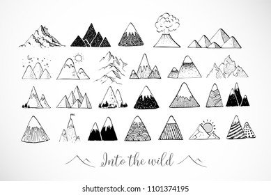 Set of hand drawn doodle sketch mountains on white background.