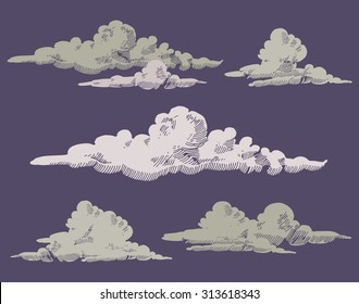 set of hand drawn engraved grey clouds