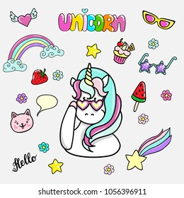 Set of hand drawn illustrations of a magic unicorn and different party attributes. Vector isolated illustration