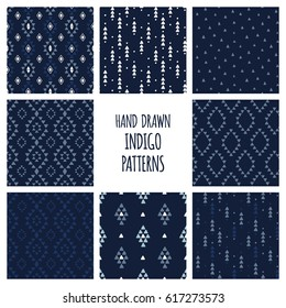Set of hand drawn indigo blue patterns. Seamless vector aztec backgrounds with triangles, arrows, rhombuses and diamonds.