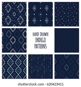 Set of hand drawn indigo blue patterns. Seamless vector native american backgrounds with triangles, arrows, rhombuses and diamonds.