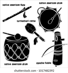 Set of hand drawn Native American traditional  musical instruments. Apache fiddle, turtle shell rattle, flute and drums. Black silhouettes technique drawing.