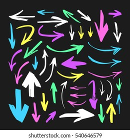 Set of hand drawn paint object for design use. Acid colors on black background. Abstract brush drawing. Vector art illustration grunge arrows