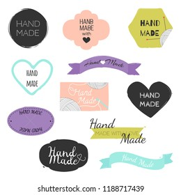 """Set of hand drawn shapes in different colour with lettering """"Handmade"""". Hearts, banners, circles and ribbons etc. Hand drawn vector various design elements for labels, tags or stamps and badges."""