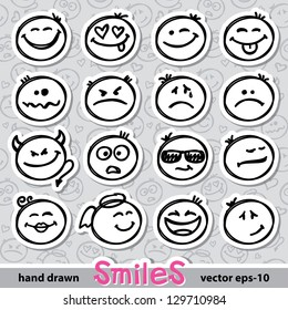 set of hand drawn smiles on realistic paper stickers