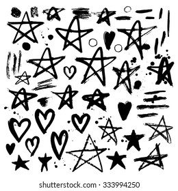 Set of hand drawn stars and hearts. Grungy elements. Brush strokes and splatter. Vector illustration.