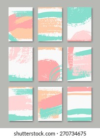 A set of hand drawn style greeting card templates in pastel blue, pink and orange. Abstract brush strokes cards with copy space. EPS 10 file, gradient mesh used.