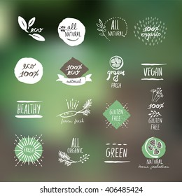 Set of hand drawn style labels and elements for organic food and drink, natural products, restaurant, healthy food market and production, on the nature background. Vector illustrations.
