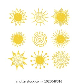 Set of hand drawn suns. Doodle drawing.