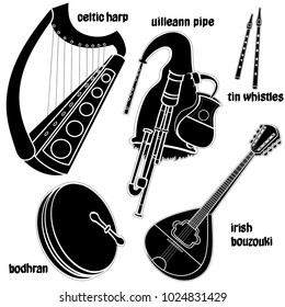 Set of hand drawn traditional Irish musical instruments. Celtic harp, uilleaann pipe, bodhran, irish bouzouki and tin whistles. Black silhouettes technique drawing.