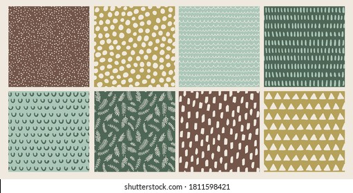 Set of hand drawn vector abstract doodle patterns winter, earthy tones. Seamless doodle backgrounds with  dots, branches, brush strokes, triangles.