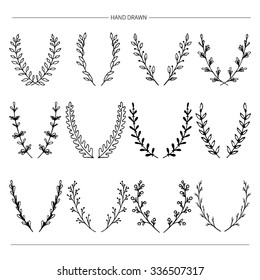 Set of hand drawn vector  decorative elements for your design. Laurels,branches.