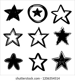 Set of hand drawn vector stars in doodle style on background. Could be used as pattern or standalone element. Brush marker sketchy