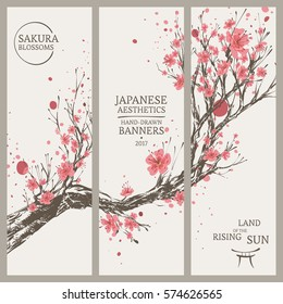 Set of Hand Drawn Vertical Banners in Japanese Style with Vivid Blooming Sakura Branch