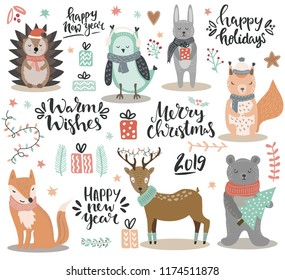 Set of hand drawn winter woodland animals and christmas lettering and other design elements