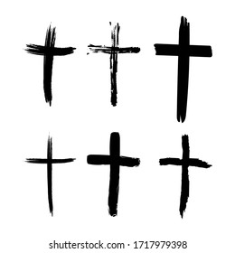 Set of hand-drawn black grunge cross icons, collection of simple Christian cross signs, hand-painted cross symbols created with real ink brush isolated on white background.