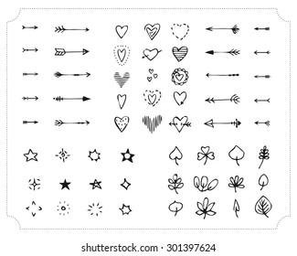 Set of hand-drawn black handle elements. Decorative design elements. Arrows, hearts, stars, lights, leaves. Vector.