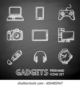 Set of handdrawn blackboard GADGET icons with - notebook and phone, gamepad, photo camera, tablet, pc, flash card, headphones, watches. Vector illustration