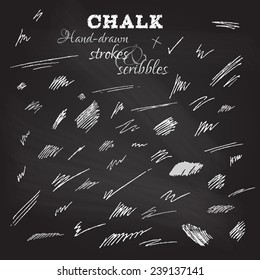Set of hand-drawn chalk strokes and scribbles. Various shapes on blackboard. Vector illustration.