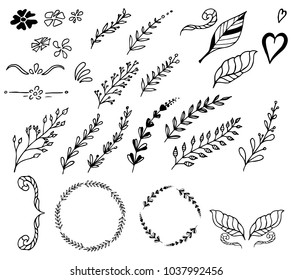 Set of hand-drawn floral elements, leaves and hearts. Vector doodles.