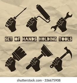 Set of hands holding tools. Vector hands holding screwdriver, paint roller, wrench, brush, hammer and plunger. Home renovation labels. Vector illustration on vintage paper background.