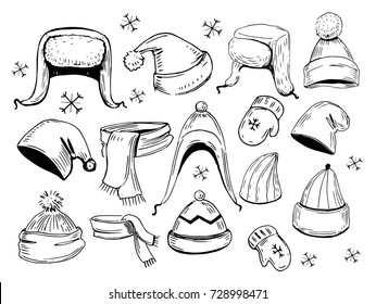 Set of hats, scarves, mittens. Hand drawn illustration converted to vector