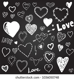 Set of heart doodles. Hand drawn vector.White on a black backgro