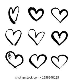 Set of hearts painted with brushes and black paint. Vector.