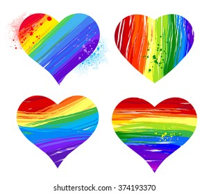 Set of hearts painted rainbow paint on white background.