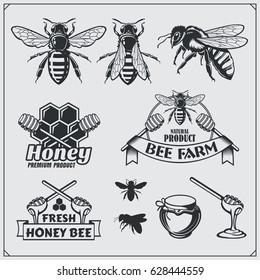 Set of honey labels, badges and design elements. Honeycombs, bees, honey emblems.