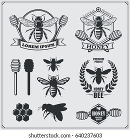 Set of honey labels, badges and design elements. Honeycombs, bee silhouettes, honey emblems.