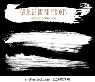 Set of ink vector stains. Grunge brush collection isolated on black