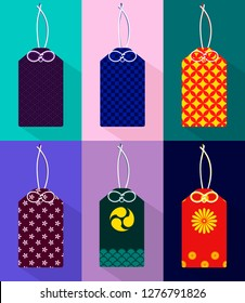 Set of isolated colorful japanese amulets omamori with different patterns on a background