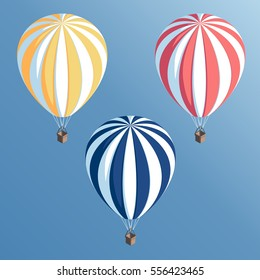Set isometric striped hot air balloons flying in the blue sky vector illustration
