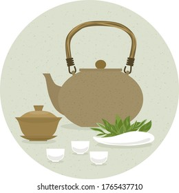A set of items for traditional Chinese tea drinking Pin Cha. The kettle, gaiwan and the green tea leaves.