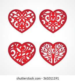 Set of laser cut heart labels. Die cut heart shapes with swirl. Swirly heart shapes for Valentine's Day. Red heart for Valentine paper card. Paper heart with swirls. Floral heart. Heart decoration.