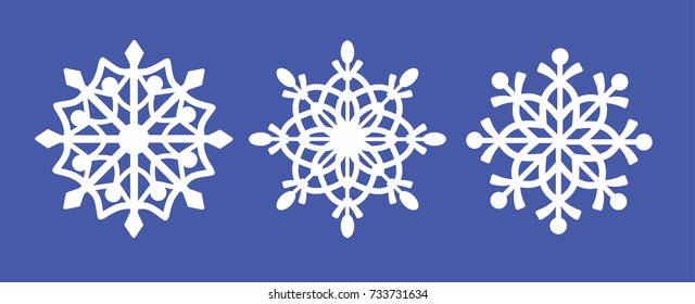 Set of laser cutting openwork snowflakes. Vector silhouette of christmas decoration. Template for paper isolated on blue background. Stencil for scrapbooking, carved wood.