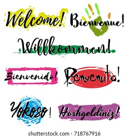 Set with lettering Welcome in different languages such as French, German, Spanish, Italian, Japanese and Turkish, with colorful splashes of paint isolated on white background. Vector illustration