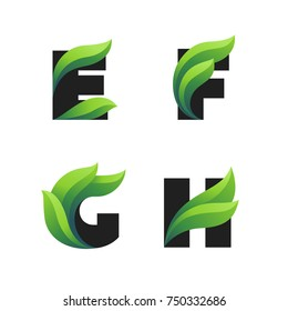 Set of letters icons with green leaves: E, F, G, H. Vector eco design.