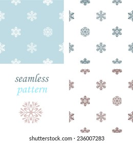 Set of light  simple seamless blue winter pattern with snowflakes