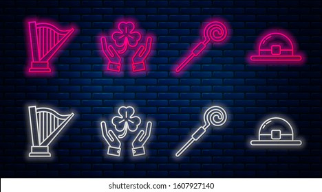 Set line Human hands holding four leaf clover, Walking stick, Harp and Leprechaun hat. Glowing neon icon on brick wall. Vector